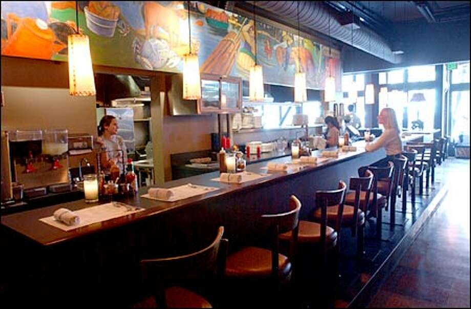 With a hint of its former self evident in the mural behind the bar, the Frontier Room today serves a Belltown crowd long removed from Seattle's early years. Photo: Jeff Larsen, Seattle Post-Intelligencer / Seattle Post-Intelligencer