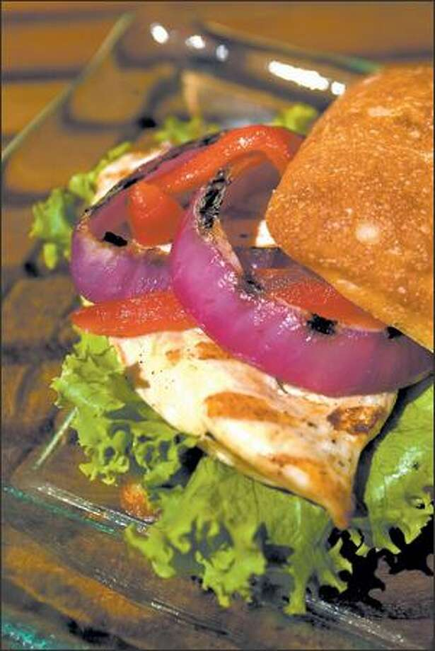 A zesty Portuguese aioli adds flavor to the grilled chicken and vegetable sandwich. Photo: Scott Eklund, Seattle Post-Intelligencer / Seattle Post-Intelligencer