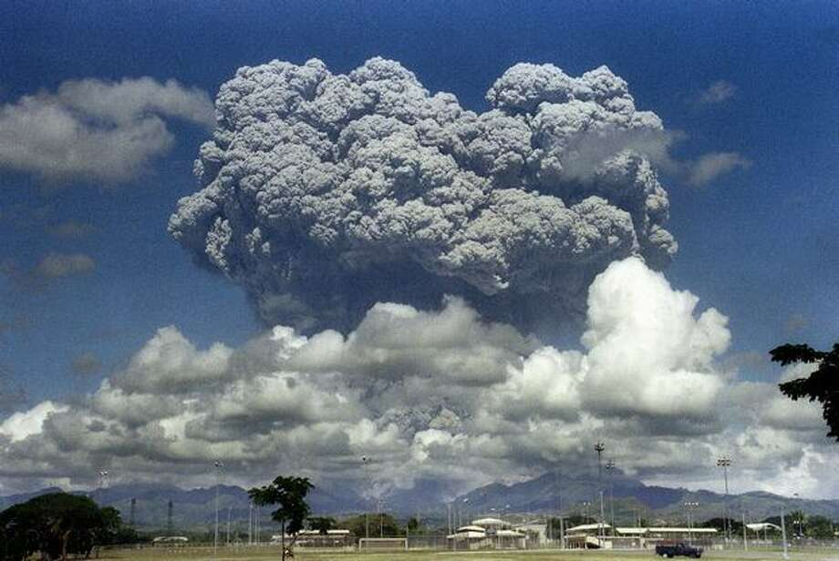 This picture taken June 12, 1991 shows a giant mushroom cloud of steam and ash exploding out of Mount Pinatubo volcano during its eruption as seen from inside the then-U.S. military Clark Air Base in Angeles, located in Pampanga province of the Philippines. Scientists think replicating this discharge of material into the upper atmosphere could help cool the planet and battle the effects of global warming. Photo: Getty Images / Getty Images