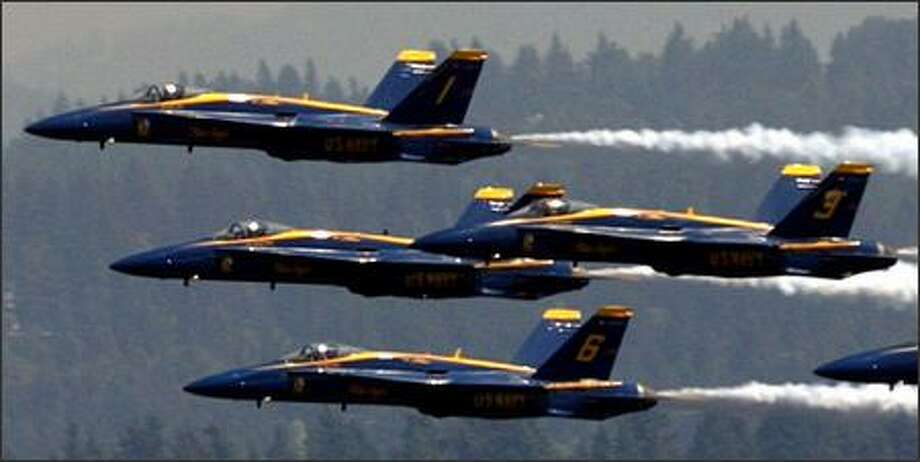 The Blue Angels buzz the boats over Lake Washington in a view from Madrona in Seattle. Photo: Karen Ducey, Seattle Post-Intelligencer / Seattle Post-Intelligencer