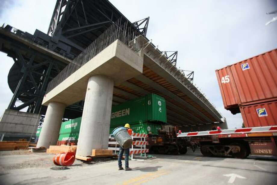 A train passes under a new ramp on South Royal Brougham Way, part of a state Route 519 construction project next to Safeco Field in Seattle. Photo: Joshua Trujillo, Seattlepi.com / seattlepi.com