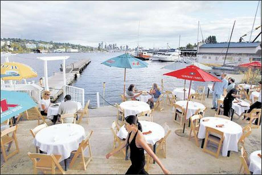 "Buena Vista's ""sand beach"" location on Lake Union allows patrons to enjoy stunning sunsets. Latin American-inspired drinks are the restaurant's other strong suit. Photo: Seattle Post-Intelligencer / Seattle Post-Intelligencer"
