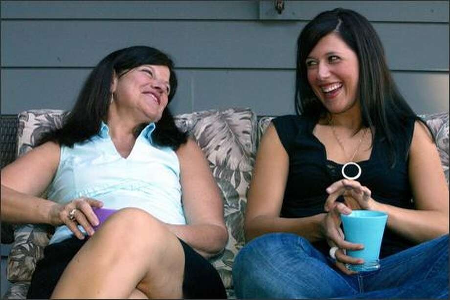 "Barbara Cast shares a laugh with her daughter Lauren Cast, who recently graduated from Seattle Pacific University. Lauren, 23, is living with her mother for a year while she teaches grade school in Bellevue. ""I am never ... embarrassed to say I live at home,"" she said. Photo: Karen Ducey, Seattle Post-Intelligencer / Seattle Post-Intelligencer"