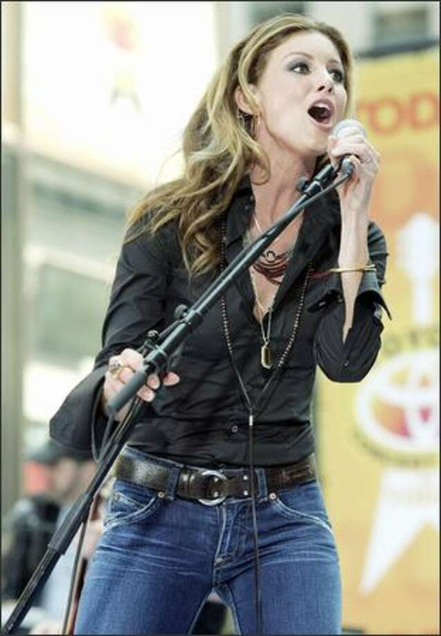 "Still classy and sexy without showing half the flesh of her younger counterparts, country singer Faith Hill entertains the crowd at the ""Today"" show on Friday while promoting her new album, ""Fireflies."" Photo: Associated Press / Associated Press"