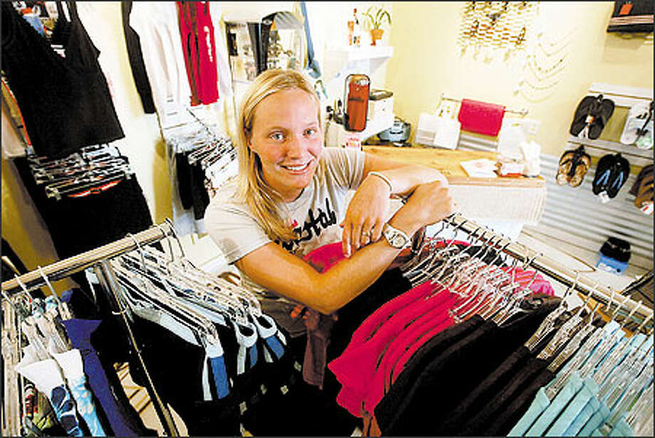 Sarah Steere, one of the two owners of Coastal Surf Boutique, has been surfing since high school. The Alki store was opened out of frustration. Steere and business partner Christy Metzger, both 27, said they couldn't find things they need for the sport. Photo: Phil H. Webber, Seattle Post-Intelligencer / Seattle Post-Intelligencer