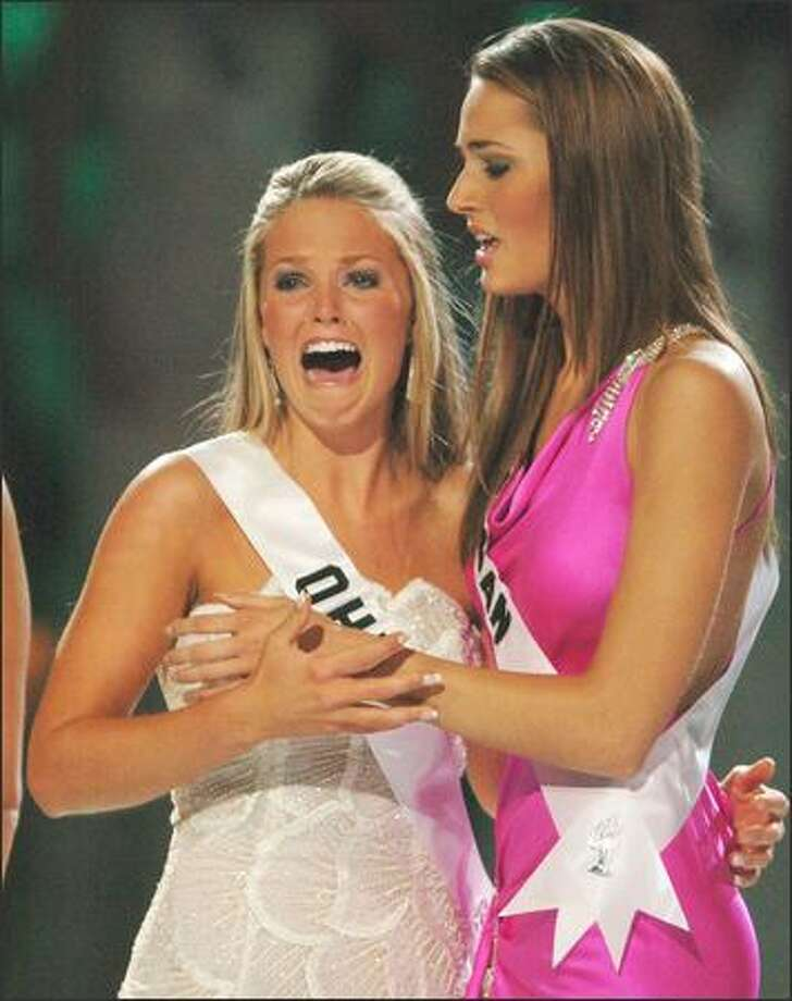 We could make an off-color remark about this scene, but here's the truth: Allie Leigh LaForce, Miss Ohio, cries out as she's named 2005 Miss Teen USA on Monday night. What looks like inappropriate touching is just Miss Michigan, Catherine Laurion, reaching to give a congratulatory hug. Photo: Associated Press / Associated Press