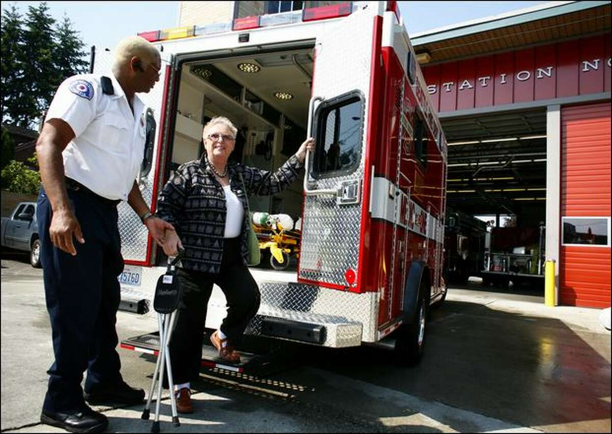 At West Seattle Fire Station 32, paramedic Christopher Hallmon helps Karen Levy out of a new medic unit, which was funded in large part by the Ed and Karen Levy Charitable Foundation.