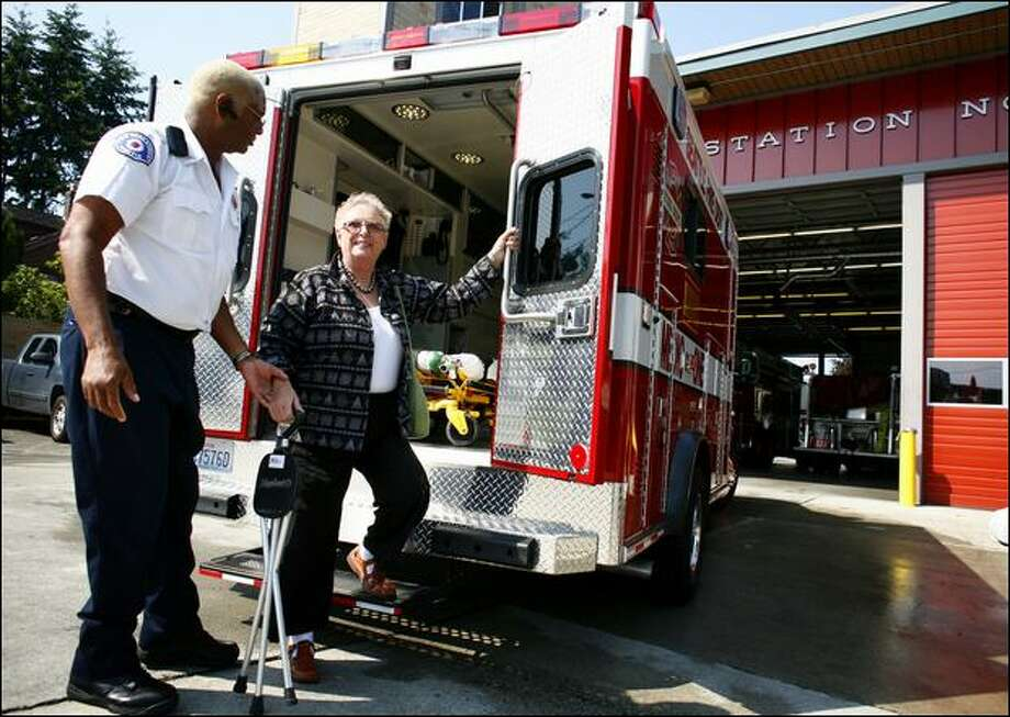 At West Seattle Fire Station 32, paramedic Christopher Hallmon helps Karen Levy out of a new medic unit, which was funded in large part by the Ed and Karen Levy Charitable Foundation. Photo: Joshua Trujillo, Seattlepi.com / seattlepi.com