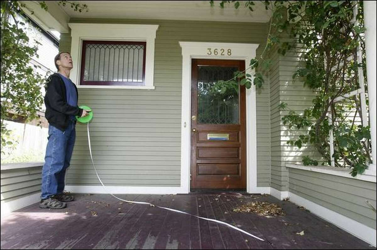 Steven Flynn, a Fremont musician, is trying to save this 1908 Craftsman house scheduled for a Wednesday demolition. A developer wants to clear the space for more townhouses. Flynn is in a last-second bid to make arrangements to buy the house and move it to his Fremont property 10 blocks away.