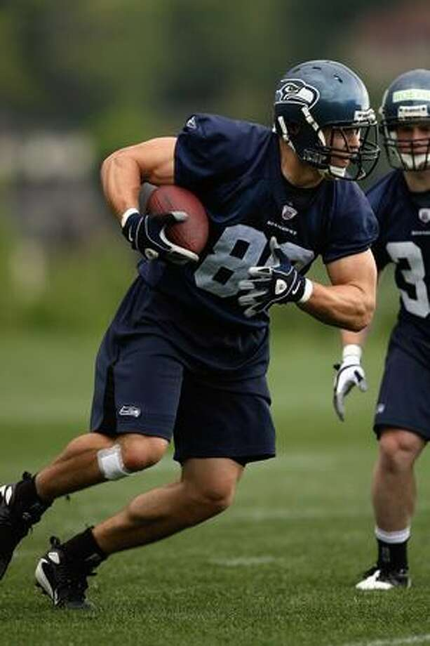 John Carlson, #89, of the Seattle Seahawks runs with the ball during minicamp at the Seahawks training facility on May 2, 2009 in Renton, Washington. Photo: Getty Images / Getty Images