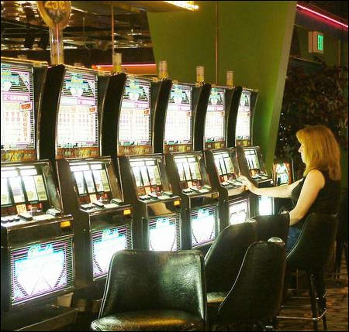 Louisa Gee of Canada plays a slot machine at the Spokane Tribe's Chewelah Casino. The state's 34 Indian gambling facilities generate $892 million.