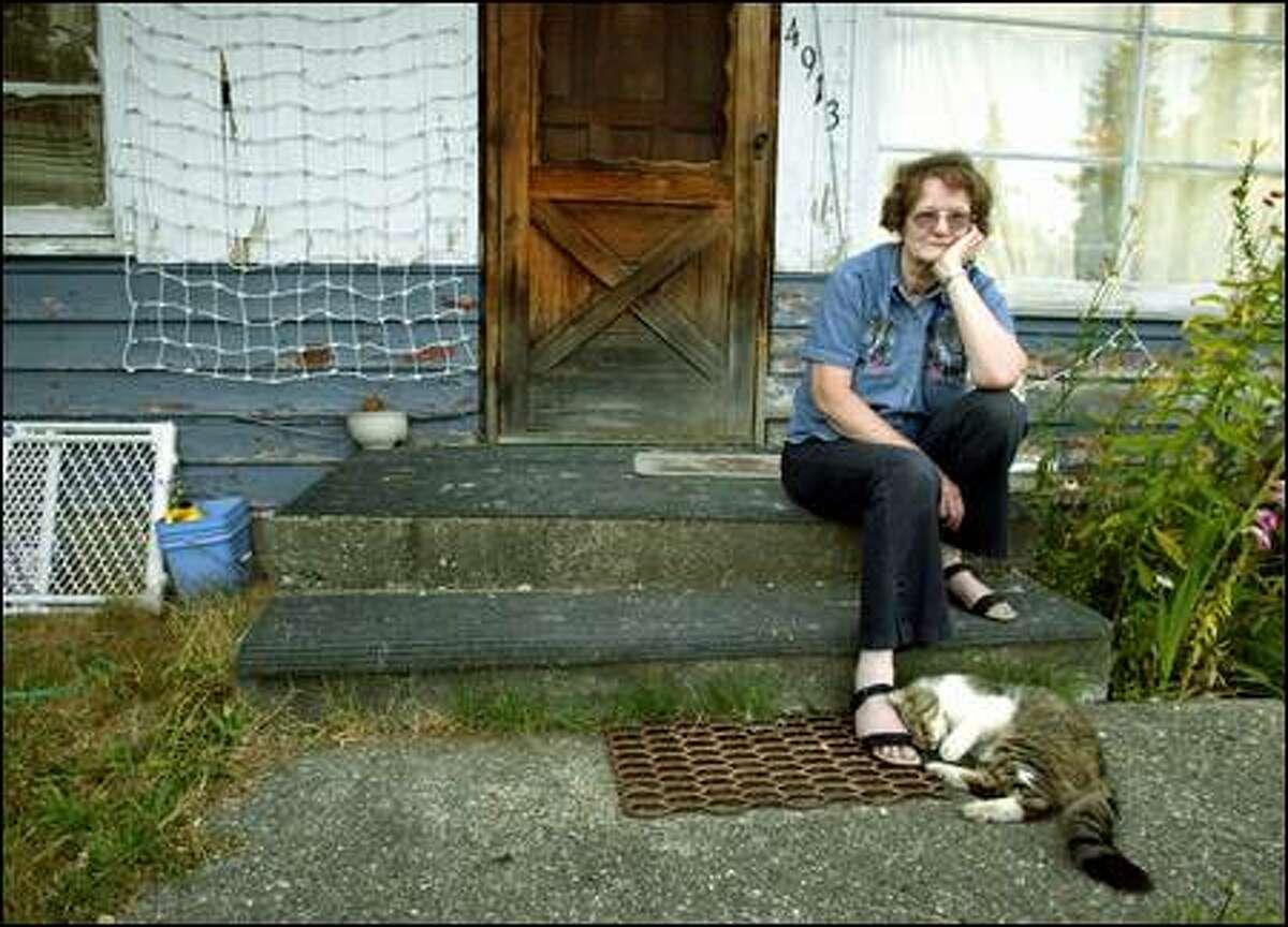 Marilyn Anderson on her front stoop in Mountlake Terrace.