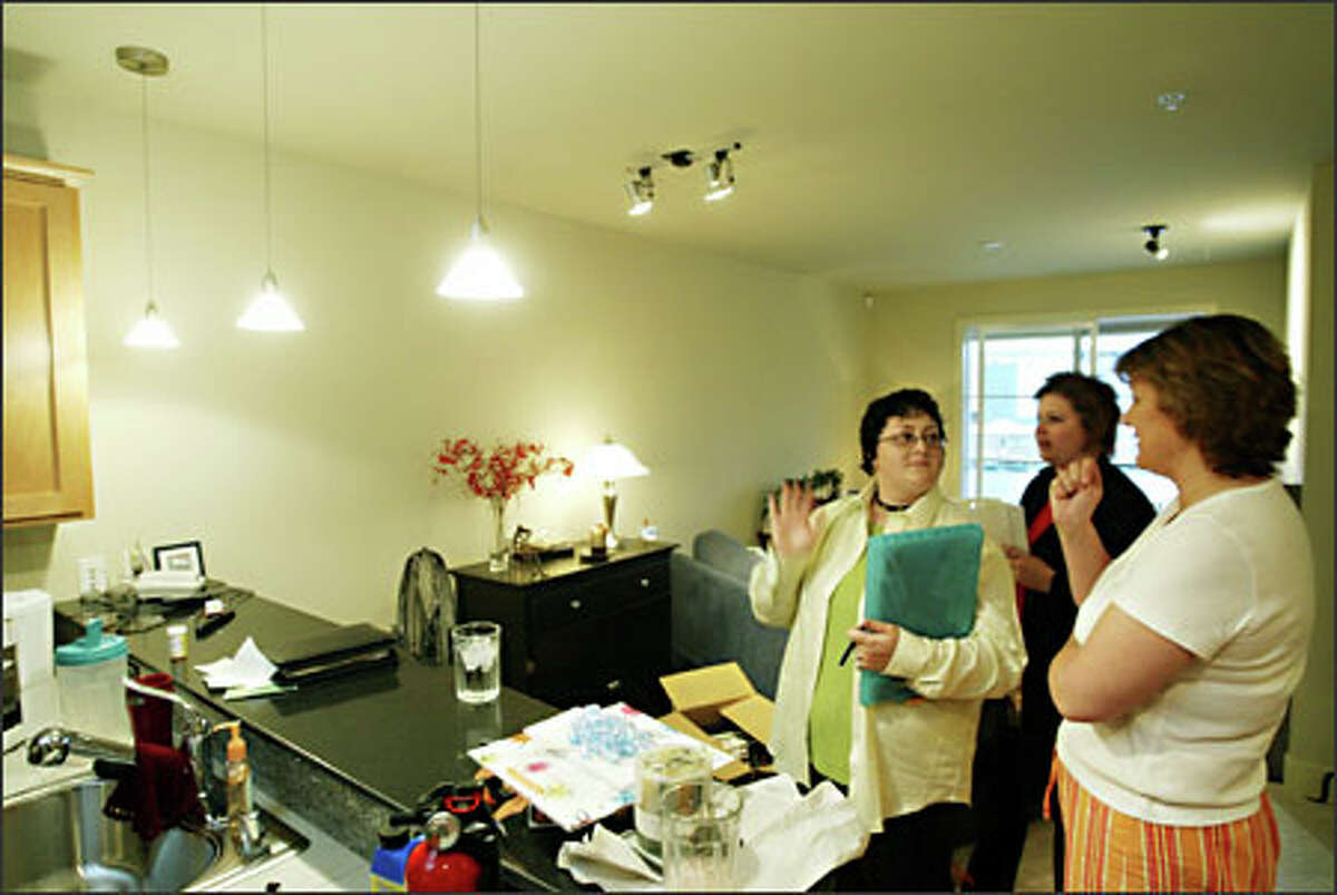 BEFORE: Color consultants Helene Mason, left, and Jeni Jones, center, help Jane Turlo, right, coordinate a good color scheme for her newly purchased condo near Green Lake.