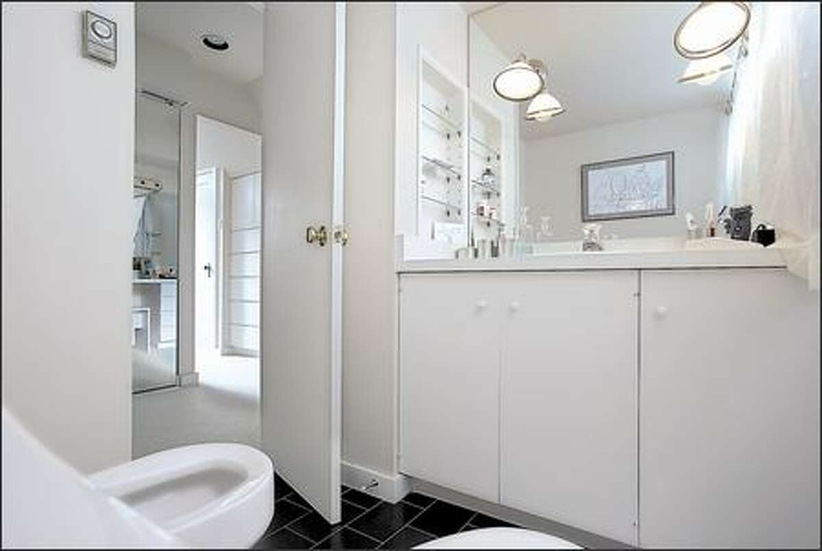 The master bedroom's small, dingy en suite bathroom was cramped and outdated.