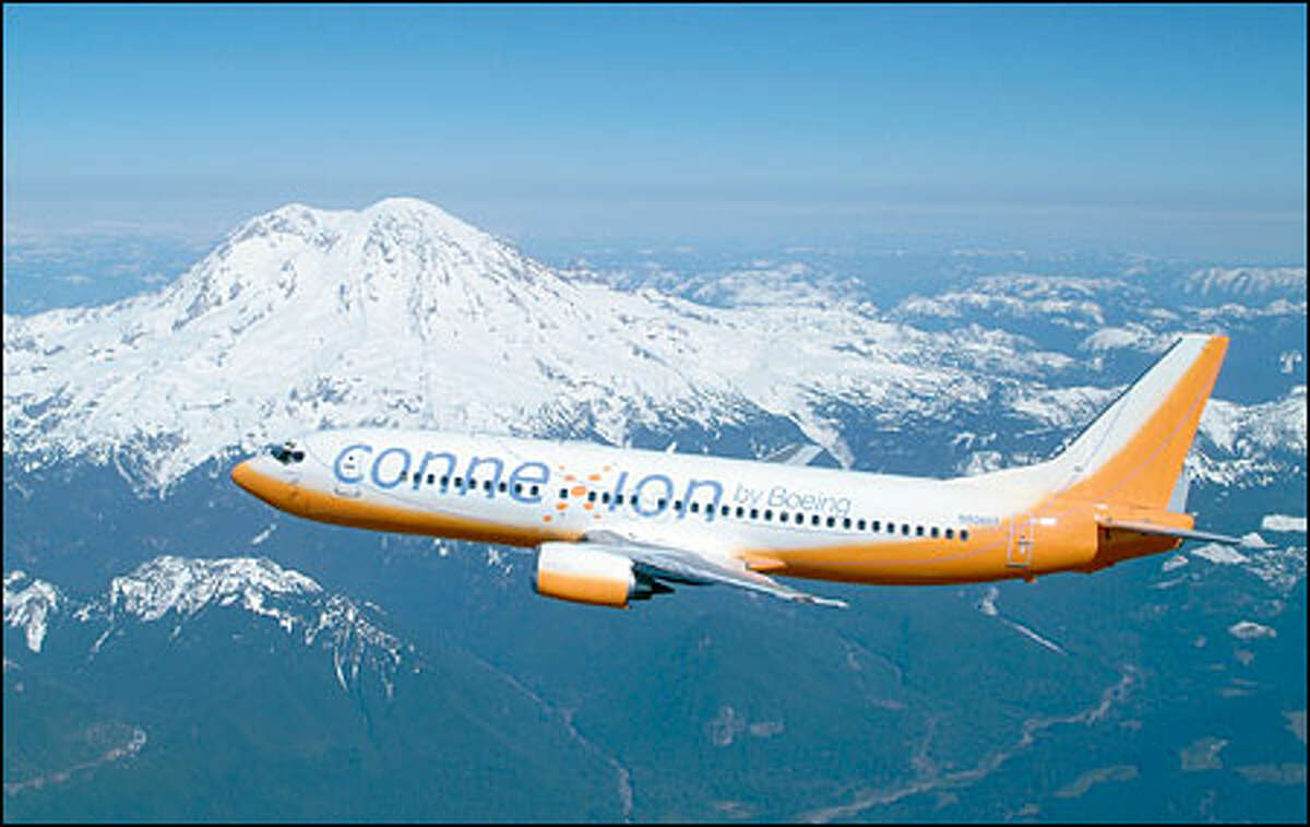 The Boeing Co. will use its familiar orange tester plane -- here flying by Mount Rainier -- to demonstrate its broadband communications service.