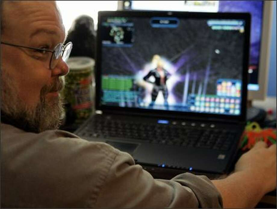 "Freeman Williams of Houston plays the video game ""City of Heroes"" with his virtual alter ego, superhero Robotrixie. Photo: Associated Press / Associated Press"