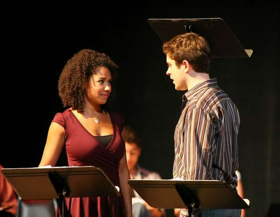 "Tanesha Ross as Nicolette and Brian Earp as Aucassin in last year's Festival of New Musicals production of ""Chasing Nicolette."" The play gets a mainstage presentation next month at the Village Theatre. (Sam Freeman photo)"