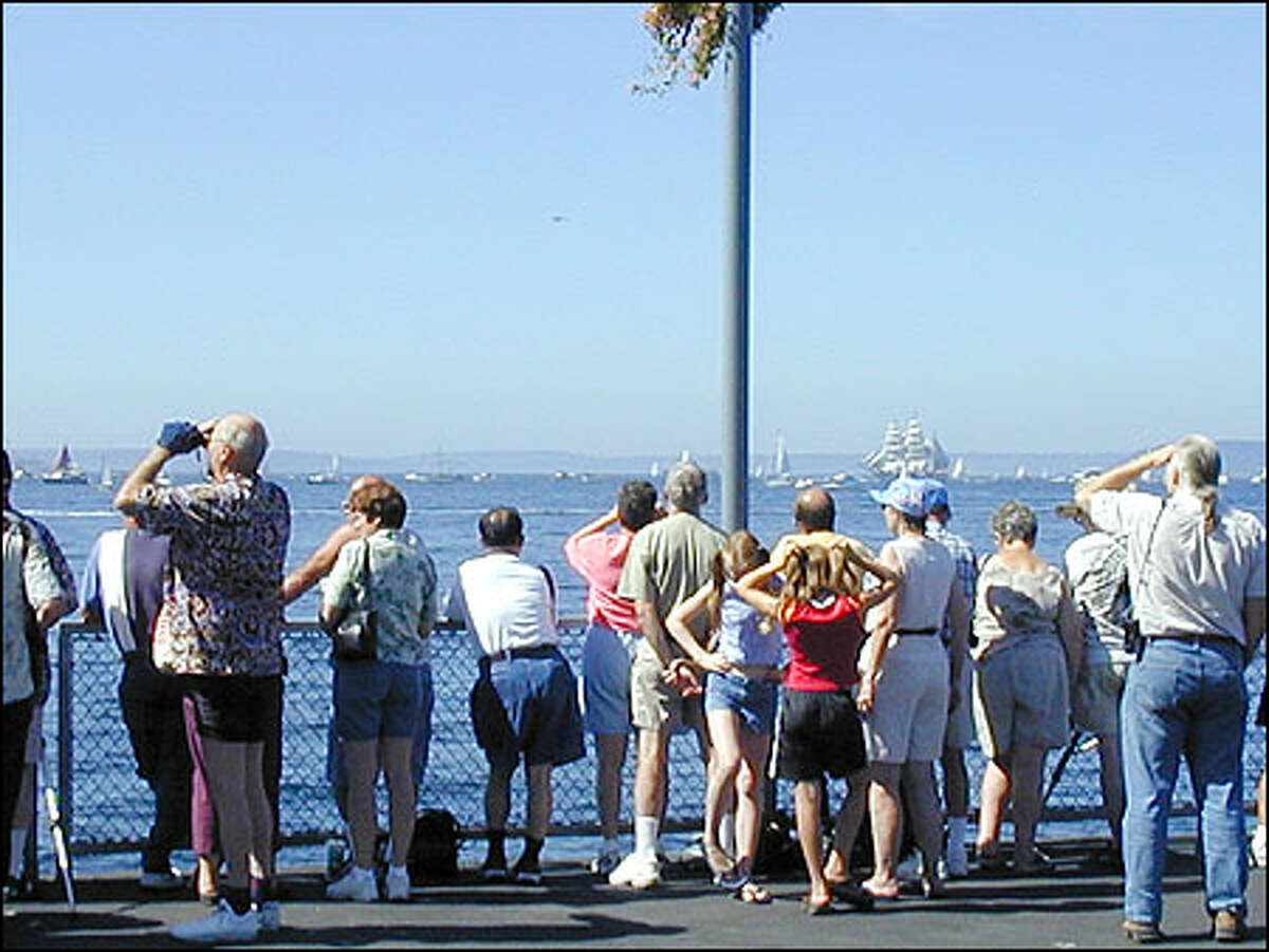 Crowds gather on Pier 70 as the tall ships enter Elliott Bay on Thursday.