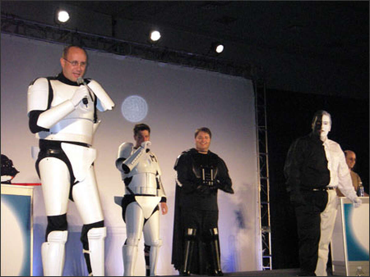 """Microsoft """"Stormtrooper"""" Bill Hilf, left, and others donned """"Star Wars"""" costumes at a LinuxWorld event last week. (Roger Binns photo)"""
