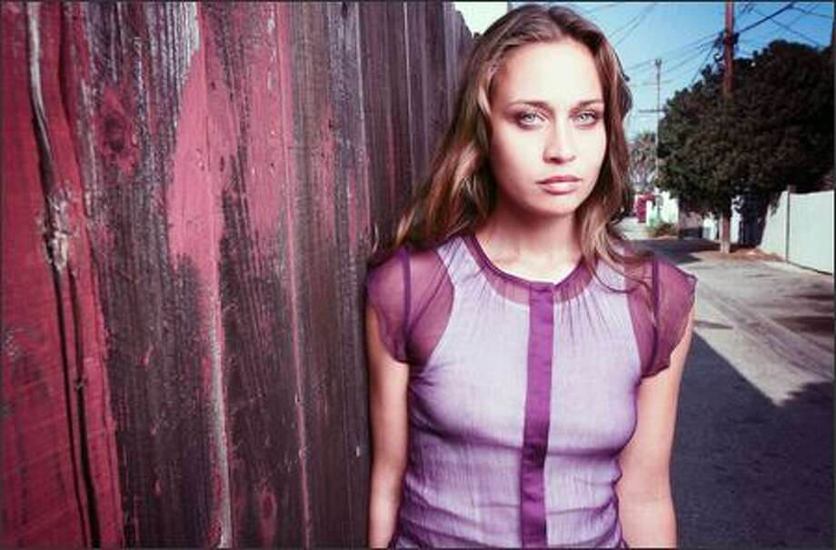 "Fiona Apple, whose third album was leaked online, has retooled it and plans to release it in October, says The New York Times. The CD also may place Apple and Epic Records ""in the unusual position of watching how fans and critics judge her new release against the leaked versions of her earlier recordings of the same songs,"" says The Times. Previews will be available Tuesday on the singer's Web site, www.fiona-apple.com. Photo: Business Wire / Business Wire"