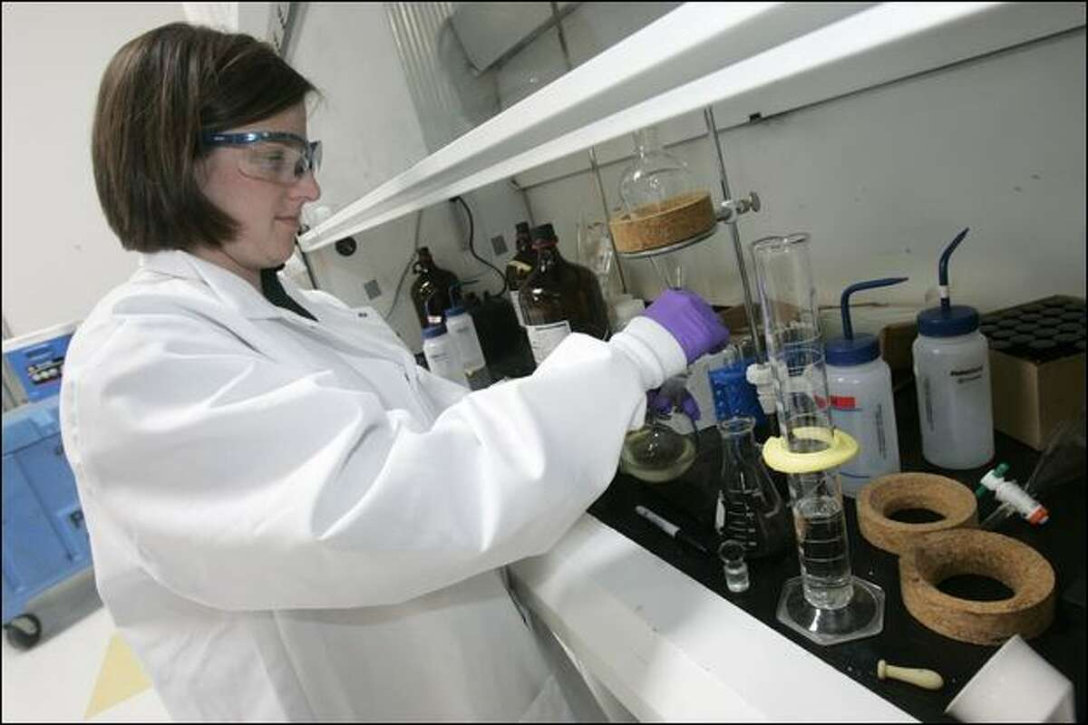 Chemist Emma Kate Payne works on turning algae into a fuel source at LiveFuels in San Carlos, Calif.