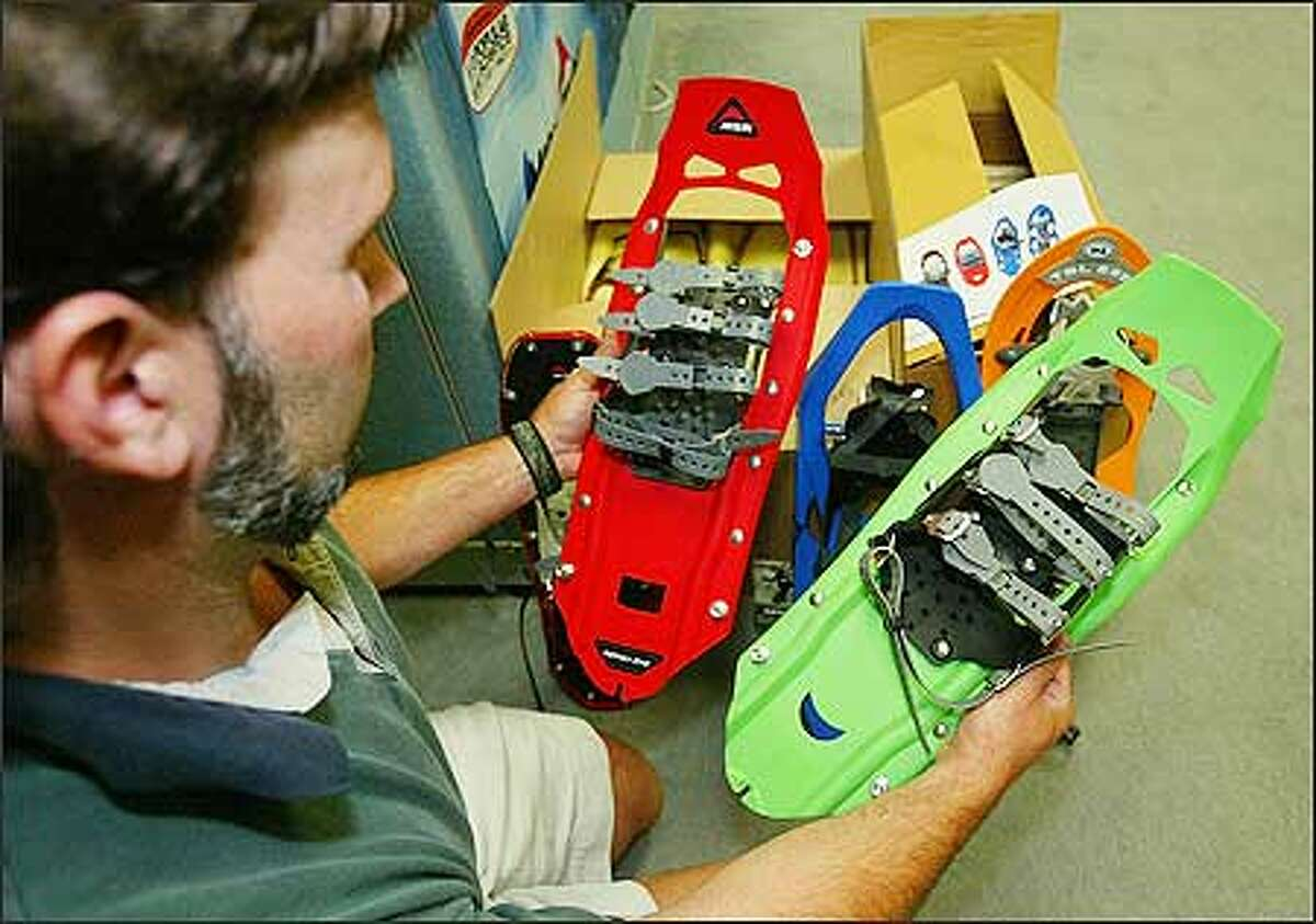 Lee Getzewich, a Cascade Designs product manager, compares a Denali Classic snowshoe, left, with a Chinese knockoff.