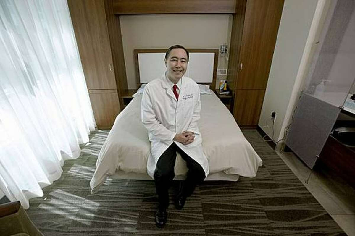 Dr. Clete Kushida, sits in one of the sleep rooms at Stanford's Center for Human Sleep Research.