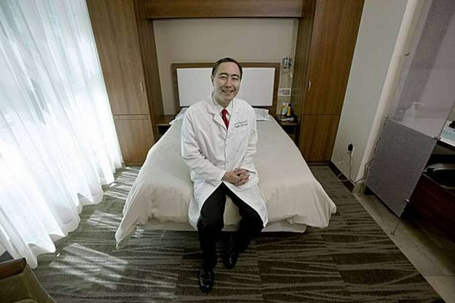 Dr. Clete Kushida, sits in one of the sleep rooms at Stanford's Center for Human Sleep Research. Photo: San Francisco Chronicle / San Francisco Chronicle