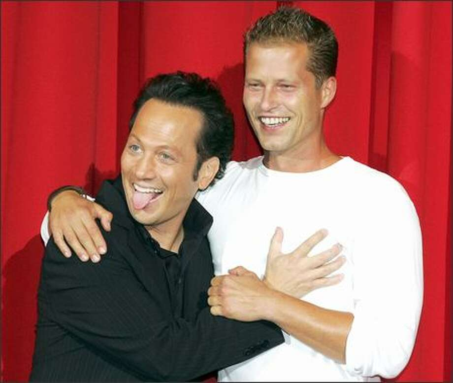 "If frisky actor Rob Schneider had a tail, he'd be wagging it. He's one happy-looking pup as he clowns with hunky German actor Till Schweiger just before the German premiere of their new comic film,""Deuce Bigalow -- European Gigolo,"" in Berlin on Tuesday. Good boy, Rob. Now sit. Photo: Associated Press / Associated Press"