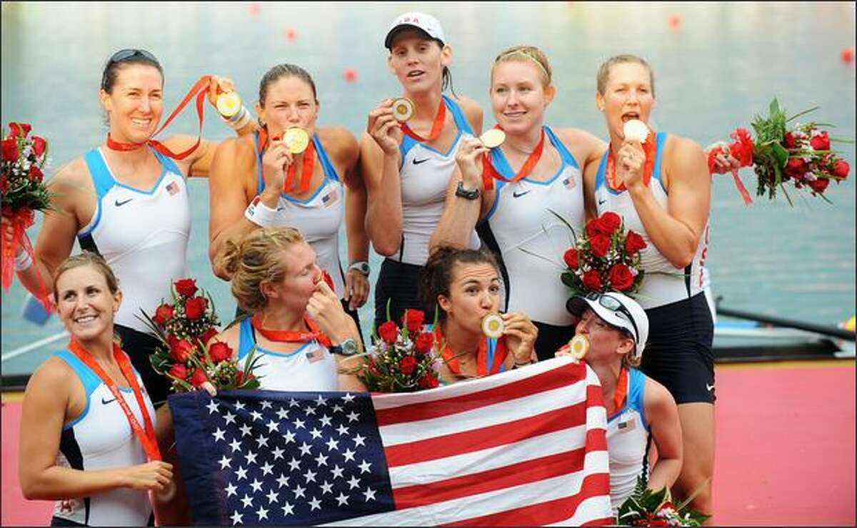 America's Erin Cafaro, Lindsay Shoop, Anna Goodale, Elle Logan, Anna Cummins, Susan Francia, Caroline Lind, Caryn Davies and Mary Whipple celebrate during the medals ceremony for the women's eight at the Shunyi Rowing and Canoeing Park in Beijing on Sunday. Cummins and Whipple rowed for the University of Washington. The U.S. won gold, Netherland Silver and Romania bronze.