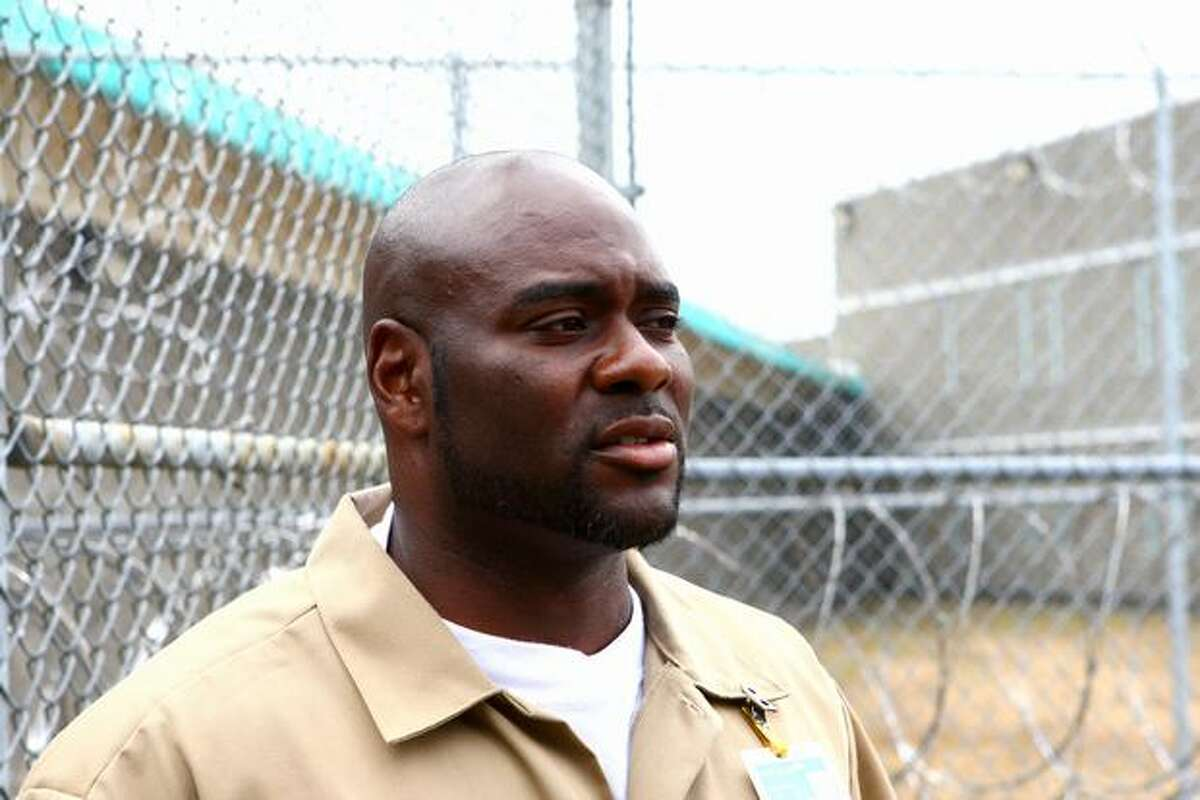 Convict Nelious Horsley speaks Wednesday at Washington Corrections Center. Horsley, who nearly lost his life in a prison riot, credits new Department of Corrections policies with helping inmates leave the gang life.