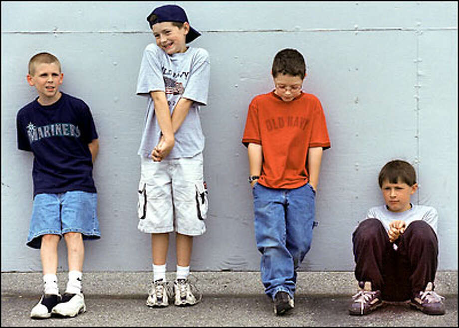 From left, Michael Hays, 11, Michael Stratton, 11, David Stratton, 9, and Ryan Lamb, 10, wait to be filmed by Kent Van Slyke, husband of Michele Van Slyke. Photo: Renee C. Byer, Seattle Post-Intelligencer / Seattle Post-Intelligencer