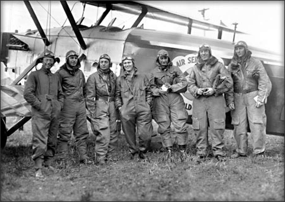 Prior to the World Flight, Arthur Turner, Henry Ogden, Leslie Arnold, Leigh Wade, Lowell Smith, Frederick Martin and Alva Harvey posed for history. E. H. Nelson and Jack Harding were absent; Turner did not fly. (PHOTOS COURTESY OF MOHAI AND PEMCO WEBSTER & STEVENS COLLECTION) Photo: Museum Of History And Industry / Museum of History and Industry
