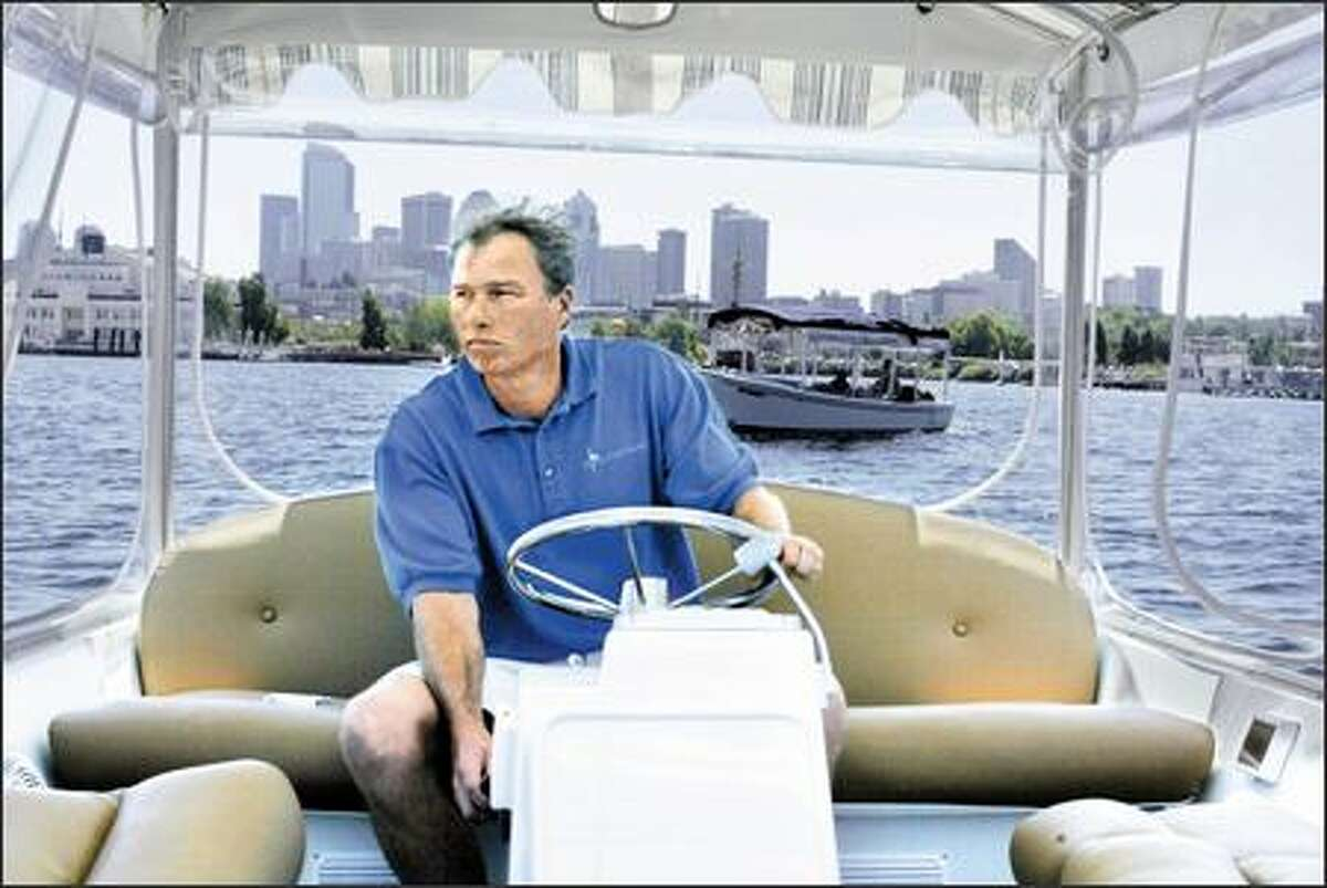 Arne Thompson, co-owner of The Electric Boat Co. on Lake Union, test-drives Electric Duffy 21 on the lake. The battery-powered boat, which sells for about $23,000, will be on display at the Seattle Boat Show at Shilshole this weekend. Thompson's company also rents the boats.