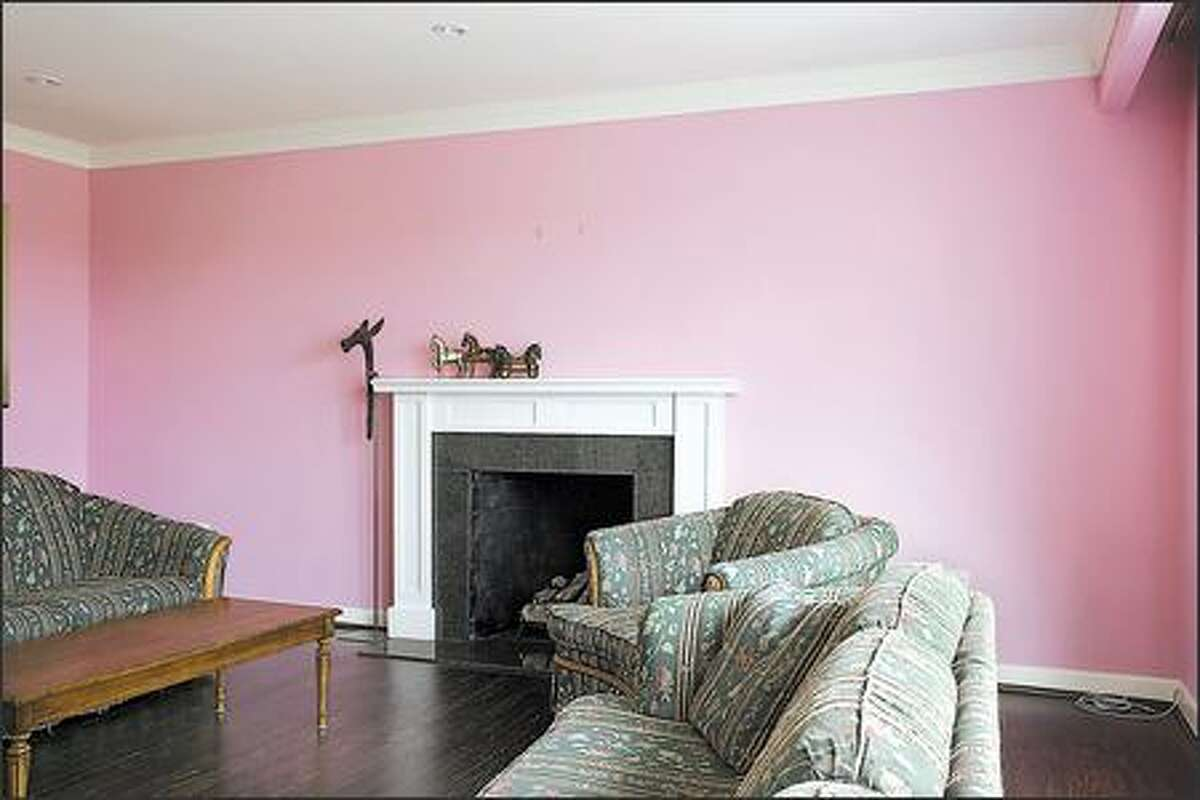 Walls in a cloying shade of bubblegum pink marred the best room in the house.