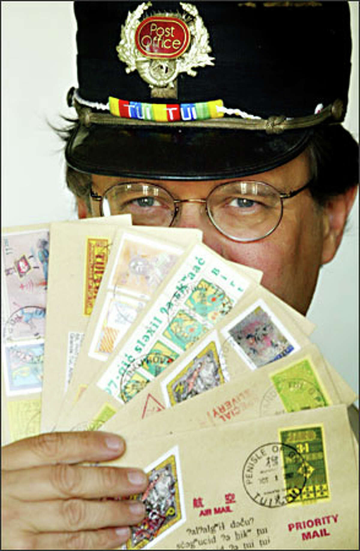 Robert Rudine's stamps are used in a postal system he created to deliver rent payments and other correspondence between buildings he owns in Seattle.