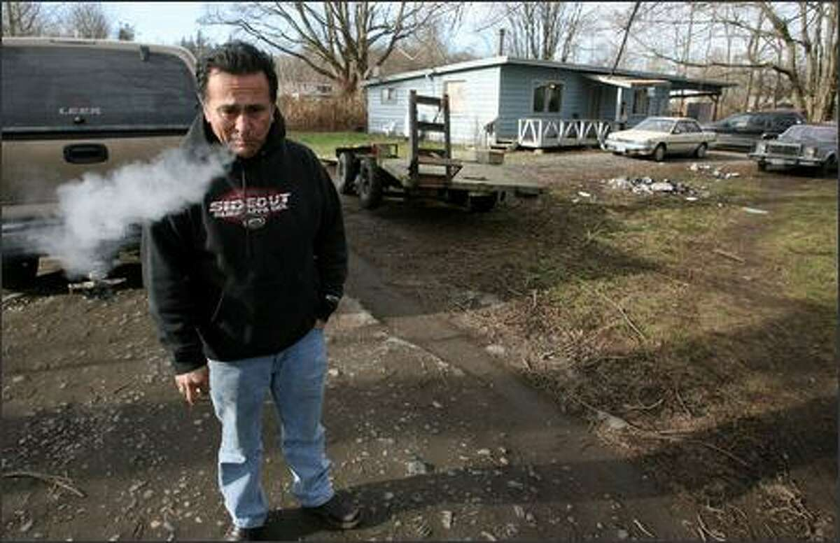 Jewell James, a Lummi Nation tribal leader, stands next to a well-known drug house on the reservation in February. James and his wife, Ramona, offer their home as a safe haven to traumatized girls. James supports more help from the FBI to fight drugs on the reservation.