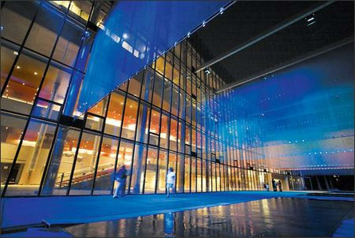 Gustafson designed the terrace promenade in front of McCaw Hall, which transforms from a kiddy wading pool by day into a sophisticated light show for adults at night.