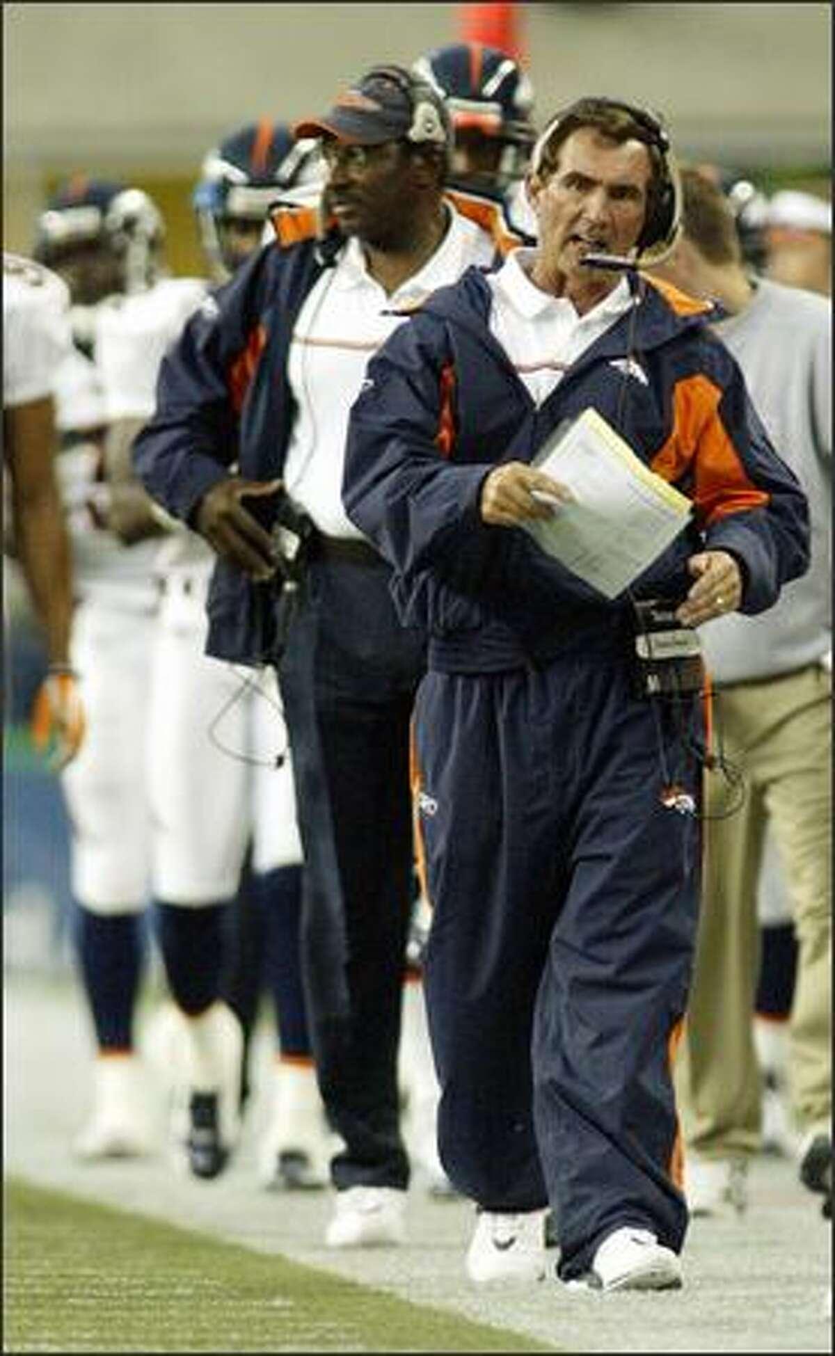 Denver Broncos' coach Mike Shanahan walks the sideline in the second quarter. (AP Photo/Ted S. Warren)