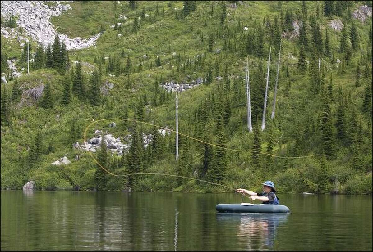 Brian Curtis of Silverdale, a member of the Trailblazers, casts his line in Monogram Lake. The Trailblazers is a club of high-lakes anglers that has been helping the U.S. Forest Service stock high mountain lakes for 75 years.