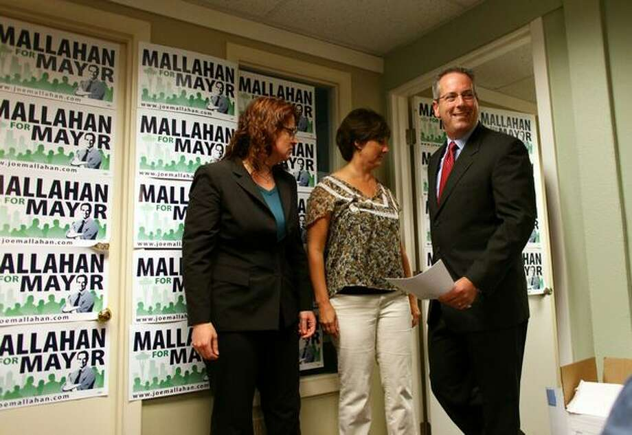 Seattle mayoral candidate Joe Mallahan walks into a room to speak to the news media in his Eastlake neighborhood campaign office after Mayor Greg Nickels conceded the primary election. Photo: Joshua Trujillo, Seattlepi.com / seattlepi.com