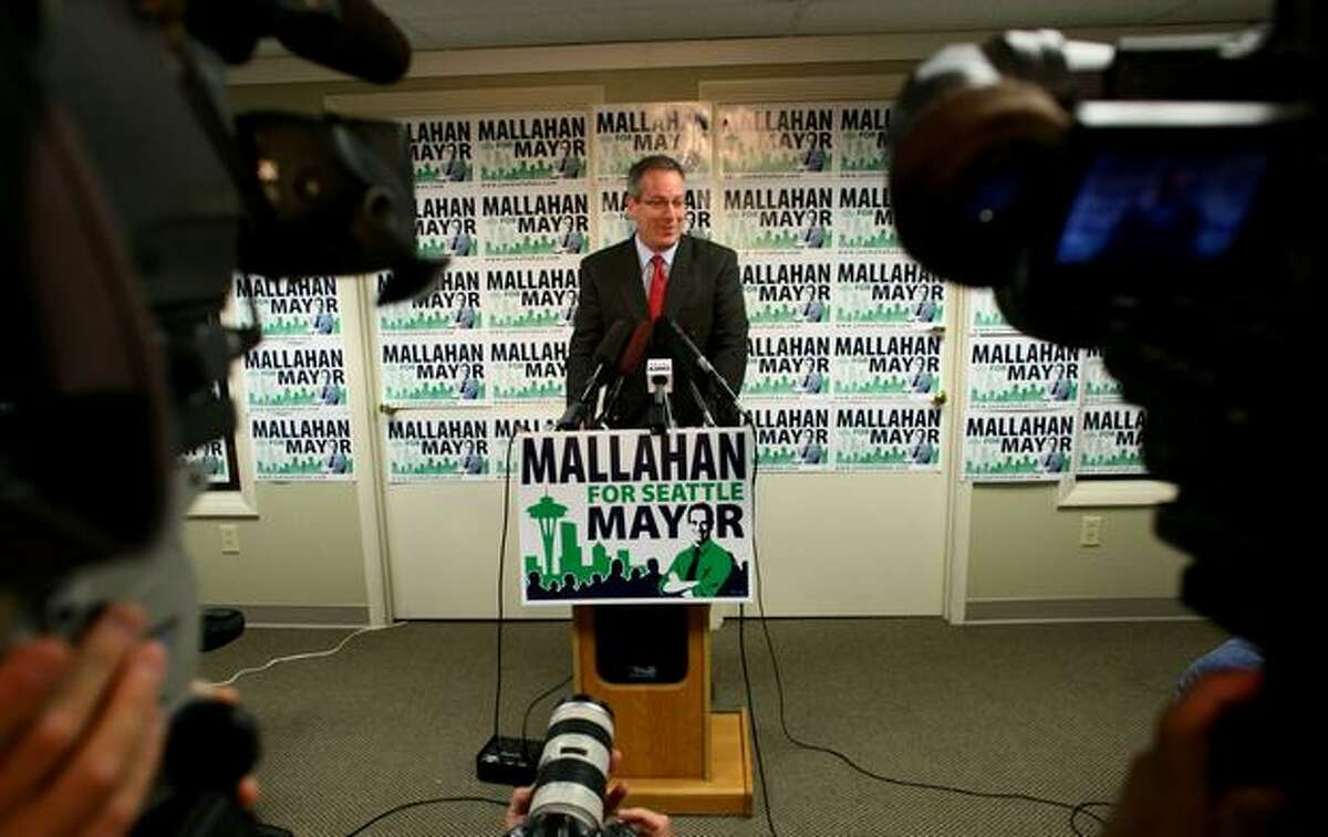Joe Mallahan, a T-Mobile executive running for mayor of Seattle, speaks to the news media in his Eastlake campaign office Friday. Incumbent Mayor Greg Nickels conceded the primary election earlier in the morning. Mallahan and Mike McGinn advance to the general election.