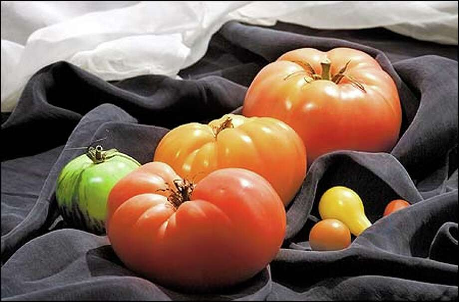 Of all the tomato varieties, the heirloom doesn't have as long a shelf life, but tastes better, says Charlene Murdock, co-owner of Murdock & White, a local specialty foods company. Photo: Paul Kitagaki Jr., Seattle Post-Intelligencer / Seattle Post-Intelligencer