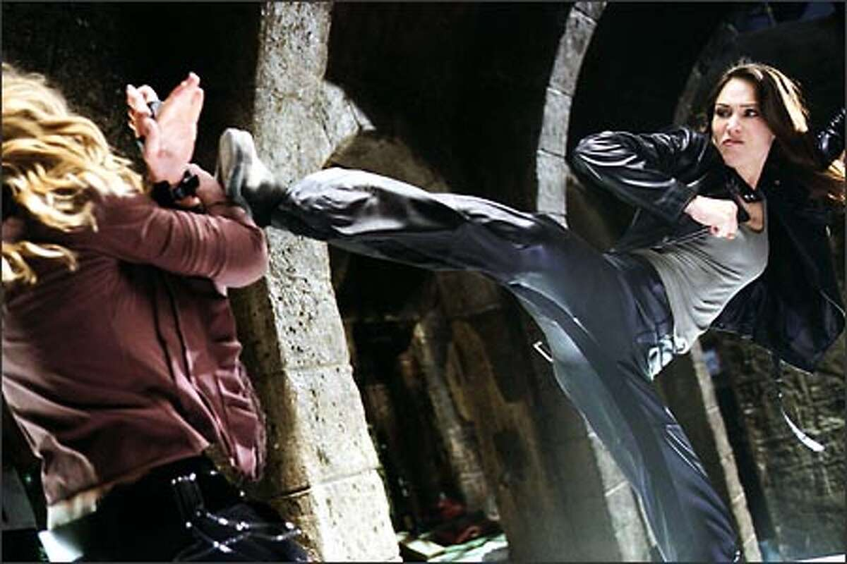 Interpol agent Nicole James (Claire Forlani) springs into action.