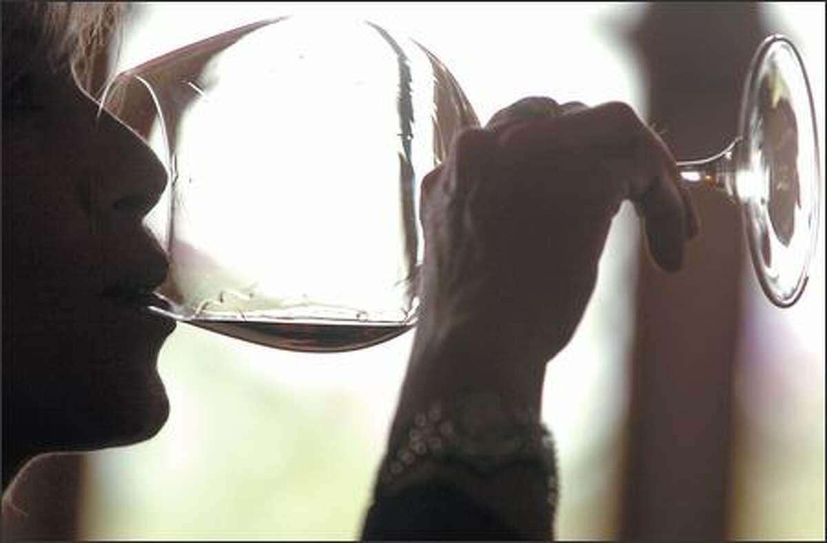 Patricia Helman, of Puerto Rico, tastes pinoit noir wine at the Domaine Drouhin tasting rooms at their vineyards in Dayton, Ore.,on Thursday