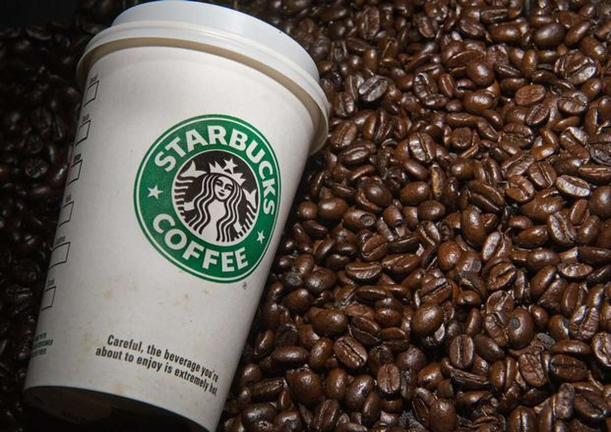 A Starbucks coffee cup and beans are seen in this photo taken August 12, 2009 in Washington, DC. AFP Photo/Paul J. Richards