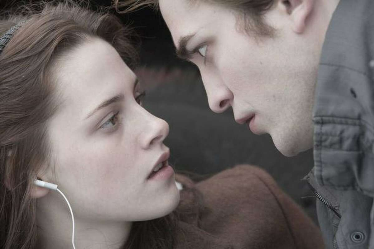 Edward (Robert Pattinson) saves Bella (Kristen Stewart) in