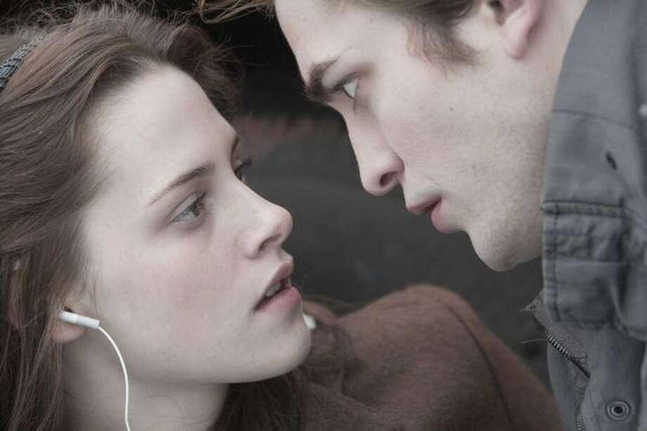 "Edward (Robert Pattinson) saves Bella (Kristen Stewart) in ""Twilight."" Photo: Summit Entertainment / Summit Entertainment"
