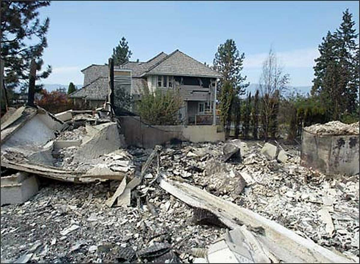 A home is completely destroyed in the Crawford Estates area in Kelowna, B.C., after a wild forest fire tore through the area.