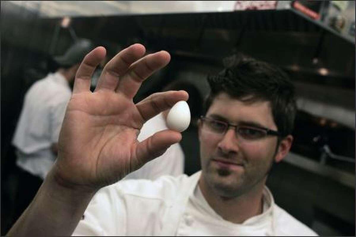 Chef Tyler Palagi displays a Bobwhite quail egg in his kitchen at Ferrara Ristorante.